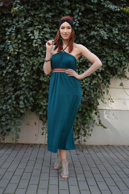 Model is wearing reversible emerald midi dress tied behind neck