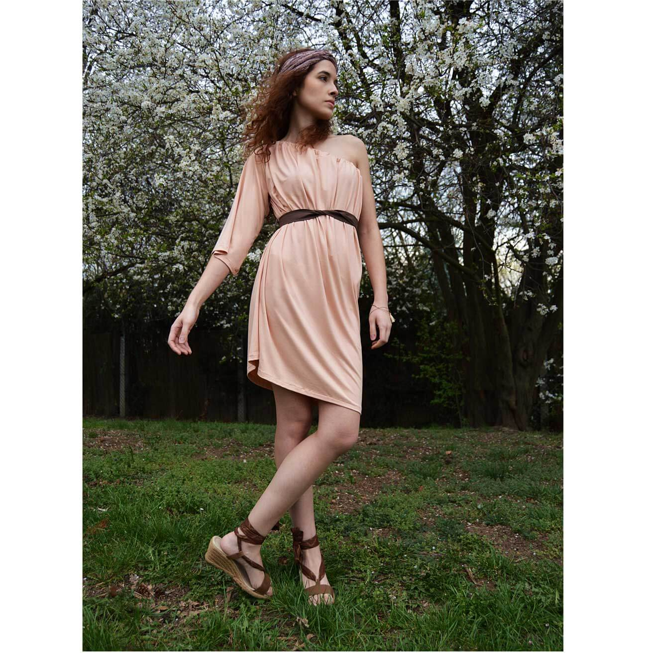Salmon pink dress with one sleeve. You can wear the dress in other ways too.