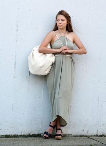 Model is wearing palegreen reversible midi dress tied behind neck